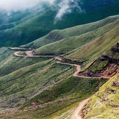 This road is the Sani Pass which passes through the Drakkenberg mountains of South Africa. At the bottom of the pass you go through passport control and and then spend the next hour or so depending on conditions crawling up with winding pass.  At the top of the pass is the country of Lesotho.  The difference between the bottom and the top couldnt be more stark. Not only is the weather and climate totally different at the top which is about 1300m higher than the bottom of the pass but the… Weather And Climate, Winding Road, Travel Photographer, Adventure Awaits, More Photos, Travel Photos, Travel Inspiration, Instagram Travel, Instagram Posts