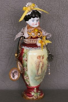 """One of a kind art doll."""" Antique china doll head, porcelain vase, lace, ribbon, jewelry and locket with photos. Porcelain Jewelry, Porcelain Vase, Painted Porcelain, Porcelain Doll, China Dolls, Assemblage Art, Doll Head, Vintage Pottery, Antique Dolls"""