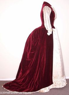 circa 1887 lady's two piece afternoon reception gown with a wine silk velvet polonaise with waterfall bustle and a full train.