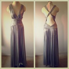 Calvin Klein Gown👏👏Host Pick🎉🎉 Authentic Calvin Klein shiny silver maxi goddess  gown. Very full when you spin💃Criss Cross back. Worn only once. Calvin Klein Dresses