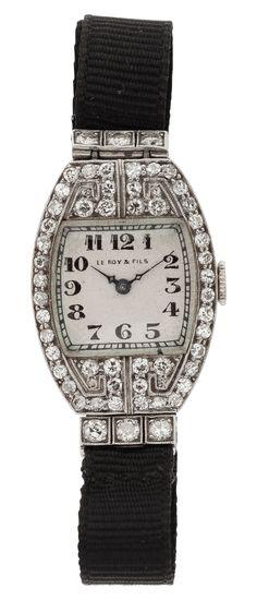 """Art Deco Le Roy & Fils Lady's Diamond, Platinum Wristwatch Case: 27.00 x 19.75 mm, 14k white gold Dial: white enamel, black Arabic numerals, blue steel """"Feuille"""" hands, Concord"""