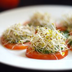 Tomato Hors d'oeuvres. Simple to make - tomatoes topped with homemade pesto and alfalfa sprouts! Best Paleo Recipes, Whole 30 Recipes, Raw Food Recipes, Veggie Recipes, Cooking Recipes, Favorite Recipes, Veggie Dishes, Yummy Recipes, Alfalfa Sprouts