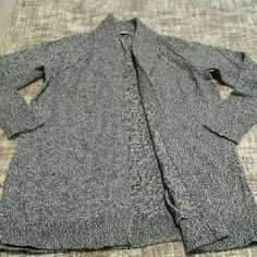 Gap long gray open front cardigan Gap Body long gray open front cardigan, dark gray mixed yarn, 100% cotton, two front pockets, size M/L.  Perfect for lounging, or wearing over workout clothes.  Excellent condition, washed and dried flat. GAP Sweaters Cardigans