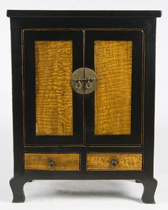 This looks a lot like a taller cabinet we own. .... Antique Chinese cabinet with black lacquered doors and natural finish burl wood---strikingly beautiful