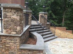 Bluestone Patio with wrought iron rails and stacked stone columns and planter. Archadeck is a masonry contractor too. We also are a deck and porch builder. Project Built in Alpharetta by Archadeck Outdoor Living of Greater Atlanta Brick Steps, Brick Columns, Patio Steps, Stone Pillars, Porch Columns, House With Porch, House Front, Front Porch, Front Door Steps