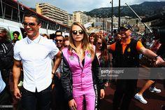 Real Madrid footballer Cristiano Ronaldo and model Cara Delevingne are seen in the pitlane before the Monaco Formula One Grand Prix at Circuit de Monaco on May 24, 2015 in Monte-Carlo, Monaco.  (Photo by Mark Thompson/Getty Images)