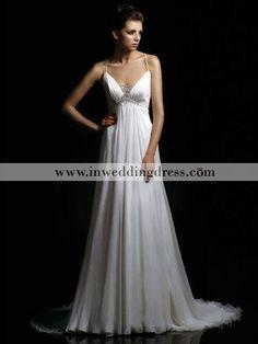 Elegant gown flows effortlessly down to the floor. Winsome V-neckline and V-back