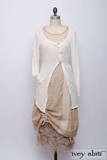 Casual, classic, feminine. Like the long lightweight sweater.