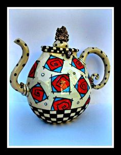 By Ann-Marie Robinson, Irish ceramic artist.  Cute and funky!  Especially love the spout.