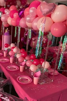 These table settings go overboard with lots of pink and sparkles. Just what a Barbie birthday party requires! The balloon decor is so impressive with all the different shades of pink. See more party ideas and share yours at CatchMyparty.com #catchmyparty #partyideas #barbie #barbieparty #barbiepartyideas #teenparty #girlbirthdayparty
