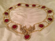 Renaissance chain of office or livery collar by Karen Troeh. Gold-plated links enameled in red and an elaborated stag or reindeer centerpiece. This one is sold, but visit my Etsy shop for more chains of office or to request a custom design.