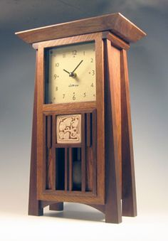 Trenton mantel clock in oak and walnut, with flat top & square face, by Cats Eye Craftsman. Accent tile is a reproduction of an Ernest Batchelder tile from the Tile Restoration Center of Seattle.