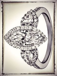 Marquise Diamond Halo Engagement Ring Pear Shape Side Stones// Holy freaking cow, I would faint.
