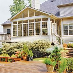 This addition's exterior was styled to match the existing house with easy-care vinyl siding and windows. Lush landscaping hides the exposed foundation and makes the addition look as though it were part of the original structure. Sunroom Decorating, Sunroom Ideas, Porch Ideas, Sunroom Diy, Interior Decorating, Decorating Ideas, Four Seasons Room, Three Season Room, Sunroom Addition