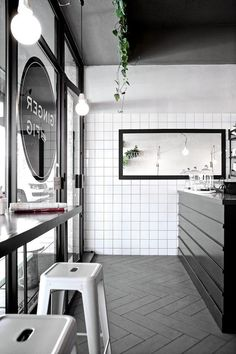 Red Hot Ops: Johannesburg South Africa - James Strack | round window decal, black and white cafe #whitetiles #subwaytiles #black&white