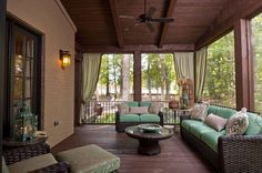 This is such a wonderful screened in back Porch.....how utterly cozy!With a fan & beautiful wicker furniture,this would be a favorite place for coffee,Iced Tea or wine depending on the time of day.....