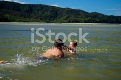 Father and Son Playing in the Sea royalty-free stock photo
