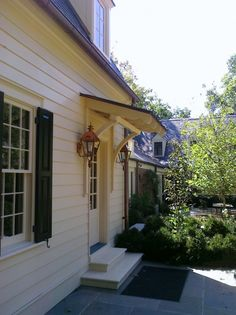 a little awning or pergola above the new front door? Something to make it pop so it doesn't get lost.