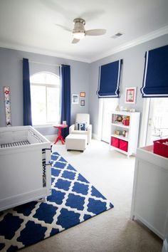 Grey blue walls, white furniture and molding, navy and red accessories!