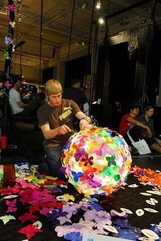 Heath Nash creating one of his amazing lamps out of plastic bottles.