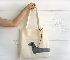 CHRISTMAS GIFT, EXPRESS Shipping, Tote Bag, Dachshund, Doxie, Weiner, Cotton Canvas Tote Bag, Market Bag, Shopping Bag, Dogs, Gift For Her  A lightweight tote bag, 100% cotton canvas with hand stitched felted design.  Approx. size 36 cm x 36cm (without handles)  Gentle hand wash in lukewarm water.  Made in a smoke free & pet free environment.  I recommend you to iron the bag as its been folded in the package. But before ironing please select the right heat setting, put a piece of clothing…