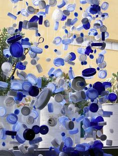 Bottle cap mobile:  get families involved in the collection of materials & the creation of the product