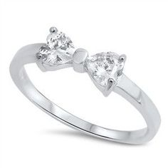 Sterling Silver CZ Bow Ring Looking for a cute ring that can be worn day or night? This adorable ring will be one of your staples. A simple CZ bow sits atop of a Sterling Silver band. Very pretty and