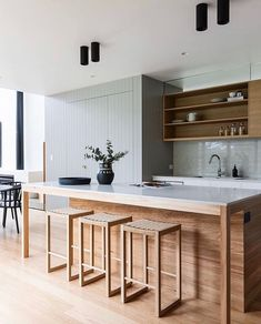 Combining neutral and natural finishes, this open kitchen uses detailed cabinetry to add texture and depth to the space. Kitchen Room Design, Modern Kitchen Design, Home Decor Kitchen, Interior Design Kitchen, Home Kitchens, Timber Kitchen, Walnut Kitchen, Open Kitchen, Sage Green Kitchen