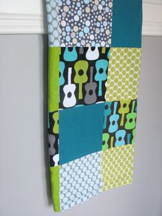 guitars & polka dots patchwork quilt backed with a lightweight flannel, perfect for cool summer nights.  #baby #quilt #patchwork #handmade