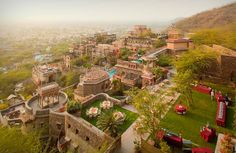 NEEMRANA FORT-PALACE RESORT. This is a reconverted 15th century fortress (originally built in 1464), spanning 25 acres with palaces tiered over twelve levels. Take a tour with jebiga.com
