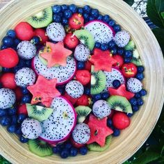 Fruit salad platter with watermelon, blueberries, kiwis, dragon fruit and passion fruit