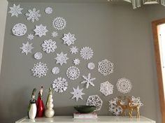 Paper Snowflakes tacked to a wall!