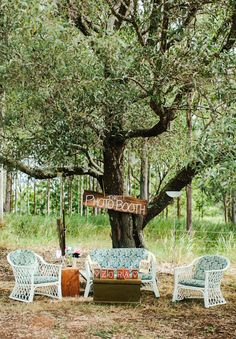 Hello May Magazine  |  A WIZARD OF OZ WEDDING: LAURA & ZANE  - chill out area and home made signs.