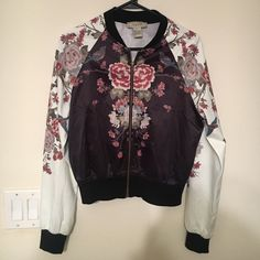 Shop Women's Flying Tomato Black size S Jackets & Coats at a discounted price at Poshmark. Description: Black body with white sleeves. All over floral print. Worn maybe 5 times. No signs of wear.. Sold by scicoria. Fast delivery, full service customer support.