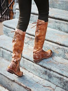 Tall boots that tie