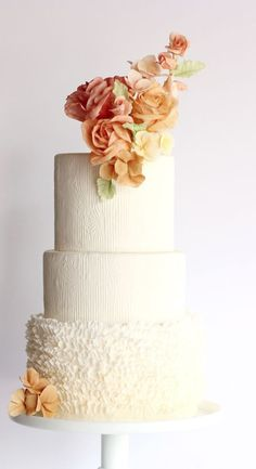 Pretty three tier white wedding cake with two different cake design textures; Featured Cake: Winifred Kristé Cake