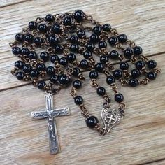 Shop stunning bronze rosaries at mariangraces.com Catholic Jewelry, Rosary Catholic, Praying The Rosary, Antique Plates, Rosaries, Crucifix, Brass Color, Black Onyx, Wedding Anniversary