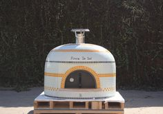 """Napolino60 outdoor pizza oven is a hand tiled pizza oven, fully assembled, ready to cook 1 - 11"""" pizza in 90 seconds, authentic Italian style center vent."""