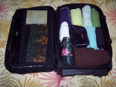 Rolling your clothes keeps them wrinkle free and utilizes suit case space.