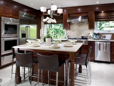 Practical Style  Rich cabinetry, state-of-the art appliances and a host of contemporary fixtures and finishes create a kitchen that's a mix of style and function. A large, square island is the focal point of the kitchen and can be used for preparation and eating