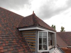 dormer window with spike roof finial