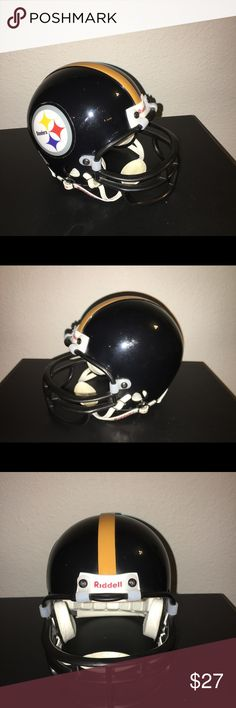 """Pittsburgh Steelers mini plastic helmet Thank you for viewing my listing, for sale is a NFL, Pittsburg Steelers, riddle plastic mini helmet. Helmet measures approximately 7"""" X 6""""   This is a vintage helmet. There are some marks on the helmet from over the years of being displayed. However overall the helmet is in good condition it would be great for any Pittsburgh Steeler fans bedroom, man cave, desk.   If you have any questions or would like additional photos please feel free to ask…"""