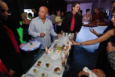 Two waiters served hors d'oeuvres on a six-foot tray.