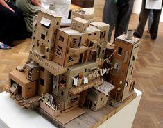 Cardboard Favela by Pamela Sullivan, photo by Tristan Brady-Jacobs Cardboard City, Cardboard Model, Cardboard Sculpture, Cardboard Toys, Cardboard Playhouse, Cardboard Furniture, Cardboard Houses, Creation Deco, Miniature Houses