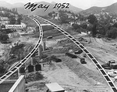 """(1952)* - This scene is just two blocks north of the famous intersection of Hollywood and Vine, the """"Heart of Hollywood."""" Steel reinforced columns jutting from the hillside will soon support new, wide ribbons of concrete approaching Cahuenga Boulevard. Freeway will be a boon to Valley motorists who use Cahuenga Pass. Click HERE to see more in Early Views of the San Fernando Valley."""