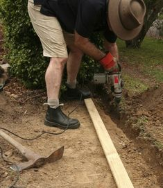 GardenDrum CStewart 3 gabion wall using a demo hammer to cut a trench for edging