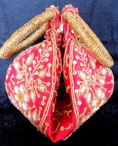 One more beauty from our potli bag collection. This red potli bag with its vibrance is sure to make you the showstopper in the next traditional party. Price Rs 549. Buy from http://giftpiper.com/Handmade-Red-Beadwork-Potli-Bag-id-415031.html