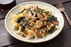 A classic stroganoff recipe made vegetarian with mushrooms and kale, with a creamy wine sauce served over egg noodles.