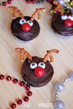 Cute Reindeer Cupcakes- I used raspberry m&ms for the nose and chocolate pretzels for the antlers