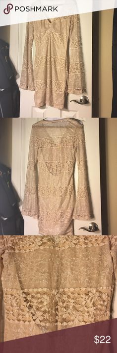 Lace tight fitting dress Goldish beige sparkly tight fitting dress, flows out on arms but body fits snug, has slip made into if! Perfect condition super sexy!! Arden B Dresses